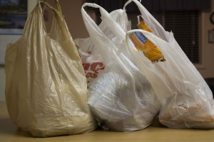 Bags of groceries sit on a table. Avoiding crisis cooking, planning a weekly menu, not buying frozen meals, shopping for generic/least expensive brand and collecting coons are some of the ways students can save money on groceries. JORDAN HINCKLEY | Scroll Photography