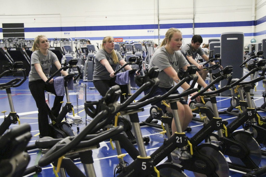 Students pedal on stationary bikes during cycling fitness class. Cycling classes are offered Monday through Wednesday from 9-9:50 p.m., Tuesday through Thursday from 8-8:50 p.m. and Thursday from 7-7:50 p.m. JAMES RIChards | Scroll Photography