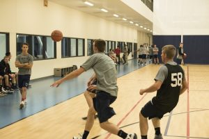 Students race for the ball before it goes out of bounds. (Logan Peterson, Scroll Photography)