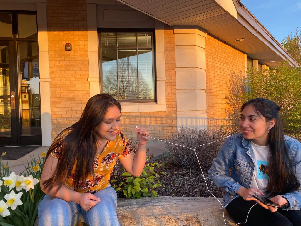 Two BYU-Idaho students sit in front of BYU-I Radio office.