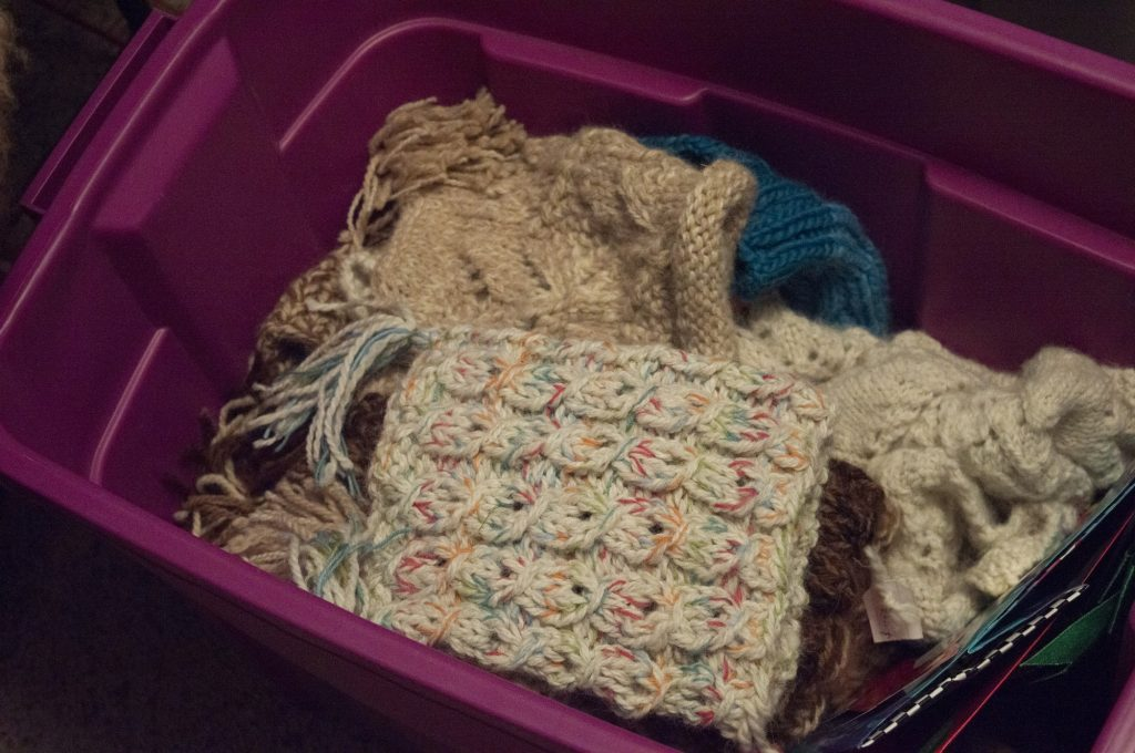 Freeman has several tubs full of hats, gloves, shawls, etc. that she's knit over the years.