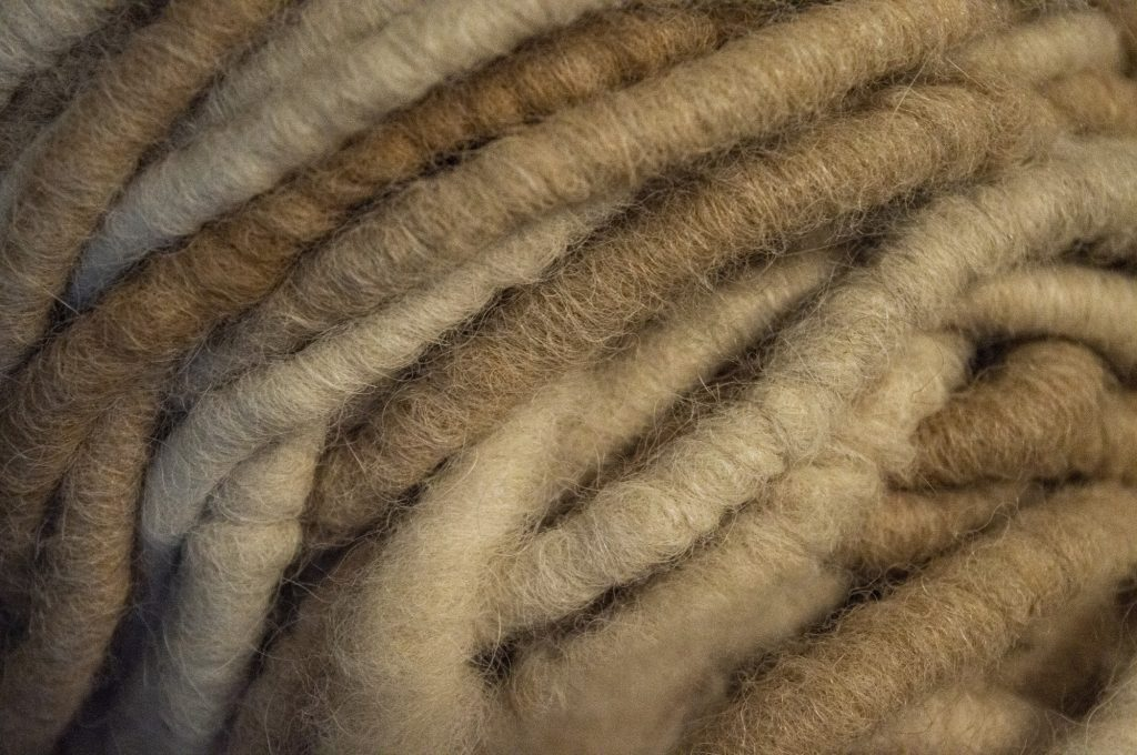 Freeman uses thick alpaca yarn to knit rugs and floor mats.