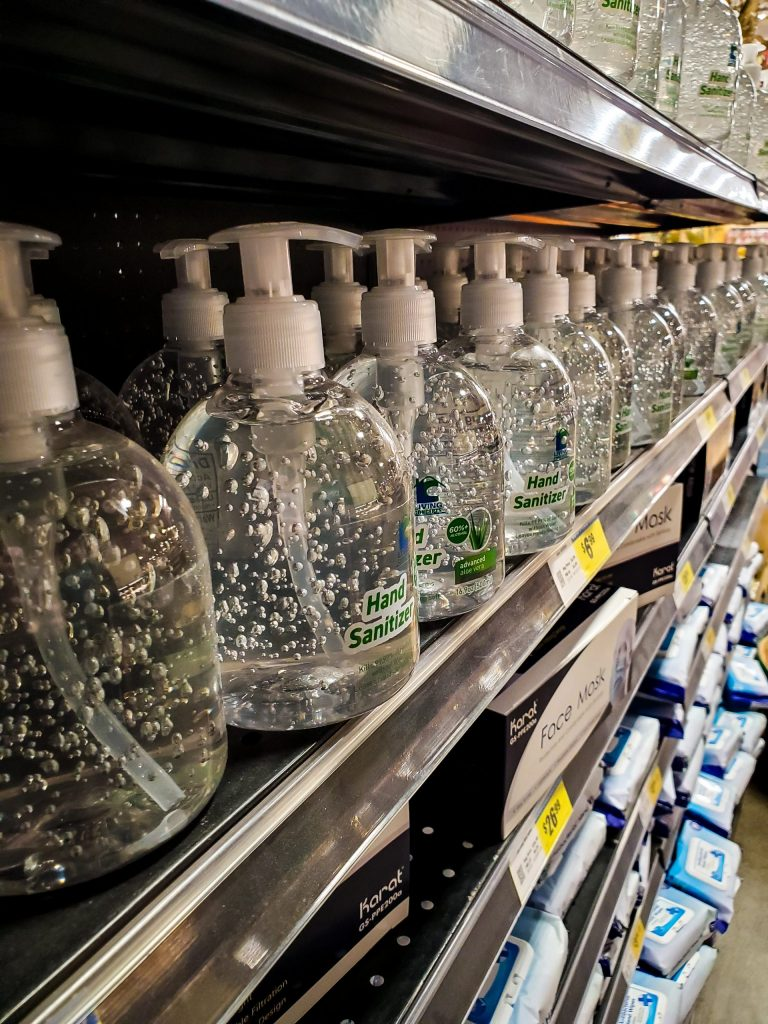 Photo courtesy of Ellie Aguiar, a photo of hand sanitizer filling a full aisle of shelving in a grocery store