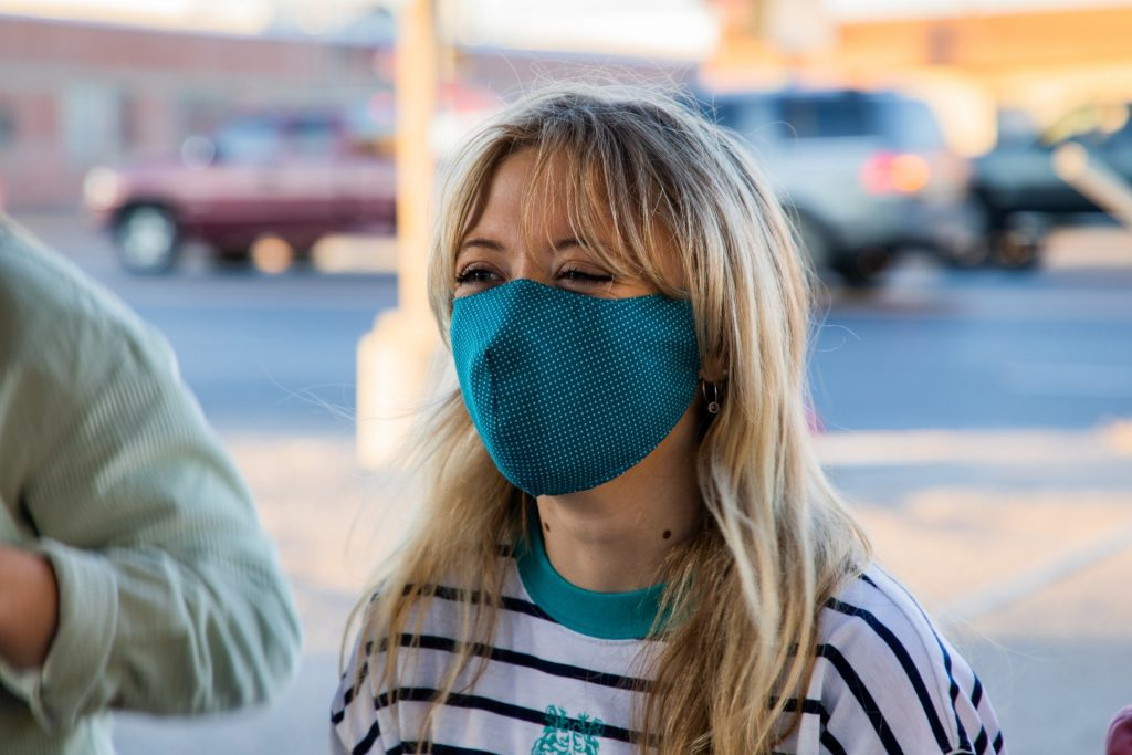 A photo of a woman wearing a homemade mask