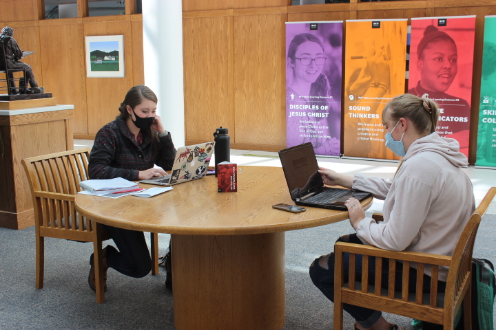 Photo courtesy of Kimberly Hunt, a photo of two students studying at a table in the Kimble building