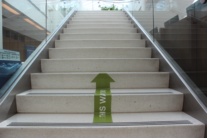 Photo courtesy of Kimberly Hunt, a photo of an arrow on the ground showing students what direction to walk up the stairs