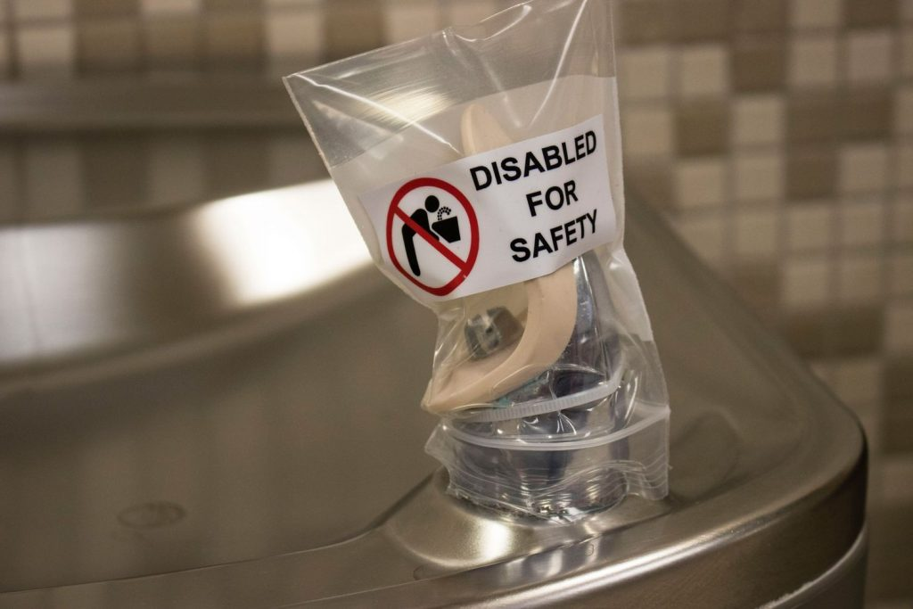 Photo courtesy of Megan White, a picture of a bag over a drinking fountain