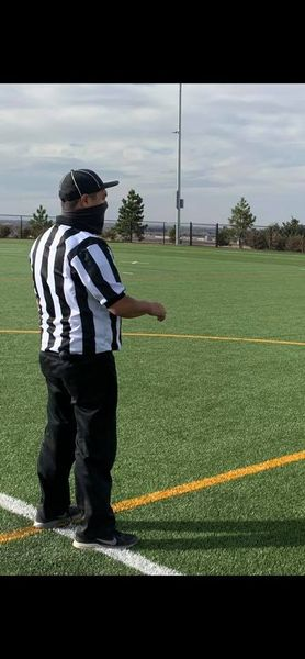 A referee ready to watch the upcoming play