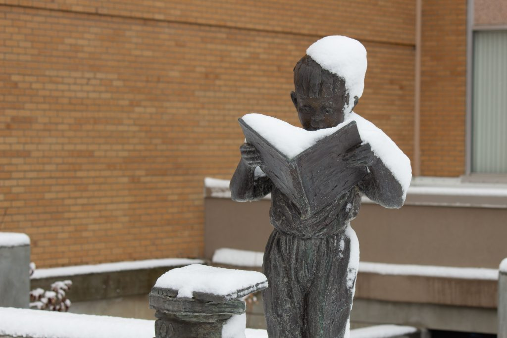 Snow on a statue.