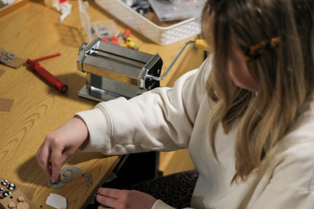Hunt stamping out star-shaped earrings.