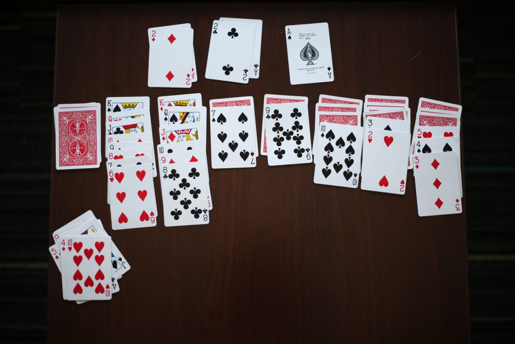 A game of Solitaire left on the table.