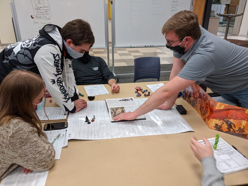 The dungeon master sets up the game, and participants make their own decisions about how it plays out.