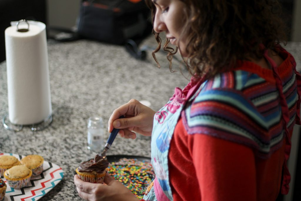 frosting a cupcake