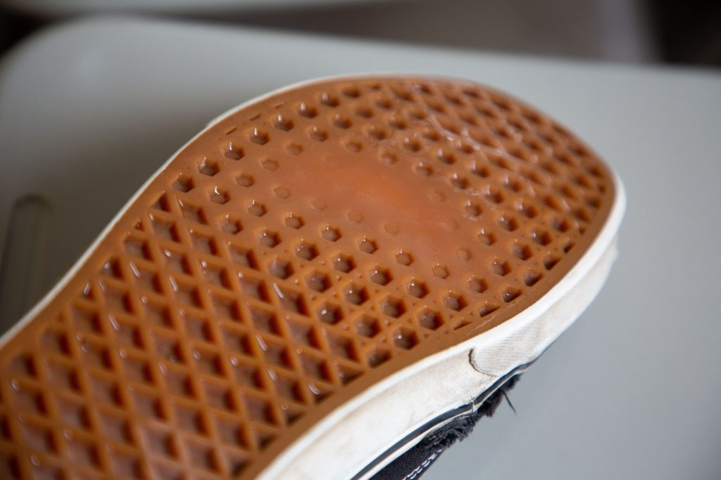 The worn sole of the shoe