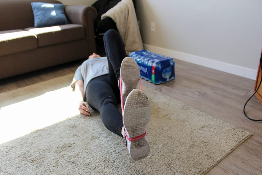 Bowman using her resistance bands.